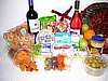 wine gift baskets with various gourmet cheese and snacks